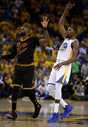 The Golden State Warriors' Kevin Durant (35) celebrates after making a 3-point shot over the Cleveland Cavaliers' LeBron James (23) in the second quarter of Game 5 of the NBA Finals at Oracle Arena in Oakland, Calif., on Monday, June 12, 2017. (Photo by Nhat V. Meyer/Bay Area News Group/TNS) *** Please Use Credit from Credit Field ***