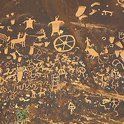 Newspaper Rock is an ancient tabloid of local events near the entrance to Canyonlands National Park, Utah.