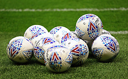 """Footballs on the pitch for the warm up before the Sky Bet Championship match at Molineux, Wolverhampton. PRESS ASSOCIATION Photo. Picture date: Tuesday March 13, 2018. See PA story SOCCER Wolves. Photo credit should read: Nigel French/PA Wire. RESTRICTIONS: EDITORIAL USE ONLY No use with unauthorised audio, video, data, fixture lists, club/league logos or """"live"""" services. Online in-match use limited to 75 images, no video emulation. No use in betting, games or single club/league/player publications."""