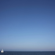A yacht sailing off the coastline of Nantucket Island, Massachusetts, USA. Photo Tim Clayton