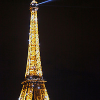 Europe, France, Paris. Eiffel Tower by night, during hourly light show.