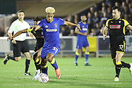 AFC Wimbledon striker Lyle Taylor (33) dribbling during the EFL Sky Bet League 1 match between AFC Wimbledon and Rotherham United at the Cherry Red Records Stadium, Kingston, England on 17 October 2017. Photo by Matthew Redman.