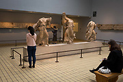 Visitors admire the Greek Three Nereids 390-380BC in the British Museum, on 11th April 2018, in London, England.