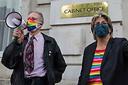 Veteran LGBT+ and human rights campaigner Peter Tatchell l and Jayne Ozanne of the Ban Conversion Therapy Coalition r address campaigners against LGBT+ conversion therapy after handing in a petition signed by 7,500 people at the Cabinet Office and Government Equalities Office calling on the government to fulfil a promise it made in July 2018 to ban the practice on 23rd June 2021 in London, United Kingdom. LGBT+ conversion treatments, which have been linked to anxiety, depression and self-harm, have been condemned by major UK medical, psychological and counselling organisations.