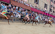 Italy, Siena, the Palio: from right Chiocciola ,Onda,  Montone  and Selva.  the straight section between the Curva del Casato heading to the arrival At the shot of the mortaretto, the horses come out of the Entrone and line up at the starting line, known as the mossa. As soon as the last horse reaches the starting line the race begins and lasts for three rounds of the square (about 1 kilometre in total). The first horse to cross the finishing line is the winner, regardless of whether it is still mounted.
