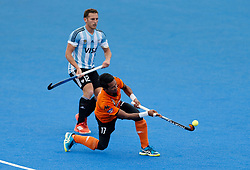 Lucas Vila of Argentina and Razie Rahim of Malaysia (right) during the Men's World Hockey League, semi-final match at Lee Valley Hockey Centre, London.