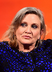 File photo dated 17/12/2015 of Carrie Fisher who has told an audience of Star Wars fans that she gave her on-screen son Adam Driver a spanking when she met him for The Force Awakens.