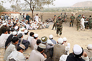 """The religious officer from the ANA 3rd Brigade, 201st Corps, speaks with villagers during an operation in Tagab Valley.....Colonel Haynes was firm about the Afghan's potential indicating they inherently understand COIN.  The ANA is a national army with each unit strictly reflecting the ethnic make up of the nation.  Unlike foreign forces they speak the same languages, understand the culture and people.  Haynes stated, """"Heck they even invented the corps religious officer who they use to relate to the people.  I never heard of it before, but I love it!""""  Each ANA brigade deploys a religious officer, or mullah, who preaches to villagers the sins of supporting violent insurgent groups.   Unconventional innovative ideas like this are essential in COIN."""