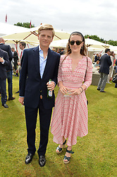 GEORGE PEARSON and SOPHIE COLERIDGE at the Cartier Queen's Cup Final 2016 held at Guards Polo Club, Smiths Lawn, Windsor Great Park, Egham, Surrey on 11th June 2016.