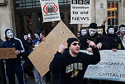 © Licensed to London News Pictures. 16/11/2013. London, United Kingdom. A protest organized by Anonymous and Occupy movment has been held outside the BBC studios. People have protested against the lack of information in the services offered by the public television channel.  Photo credit : Andrea Baldo/LNP