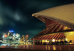 Australia, New South Wales, Sydney, restaurant at Sydney Opera House, with view of city skyline at night
