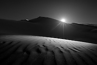 I can't describe my feelings when I put my feet on sands of Empty Quarter at the first time in my life !<br /> It looks like an endless of a gold land which takes all breaths and mind.<br /> <br /> I wished that I met some clouds that day but may be I'll have some in future. And I'm really wish that you like this composition in black and white.