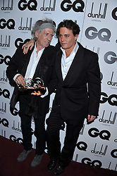 Left to right, Winner of the Writer of the Year Award KEITH RICHARDS and JOHNNY DEPP at the GQ Men of the Year 2011 Awards dinner held at The Royal Opera House, Covent Garden, London on 6th September 2011.