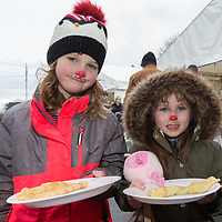 Shona Treacy and Grace Keena enjoying the crepes on offer at the Treacys West County Winter Wonderland on saturday afternoon