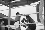 Ali vs Lewis Fight, Croke Park,Dublin..1972..19.07.1972..07.19.1972..19th July 1972..As part of his built up for a World Championship attempt against the current champion, 'Smokin' Joe Frazier,Muhammad Ali fought Al 'Blue' Lewis at Croke Park,Dublin,Ireland. Muhammad Ali won the fight with a TKO when the fight was stopped in the eleventh round...Image of Lewis as he ducks to avoid the swinging right of Ali.
