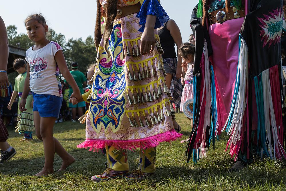 Three generations dancing at a Native American Pow Wow.