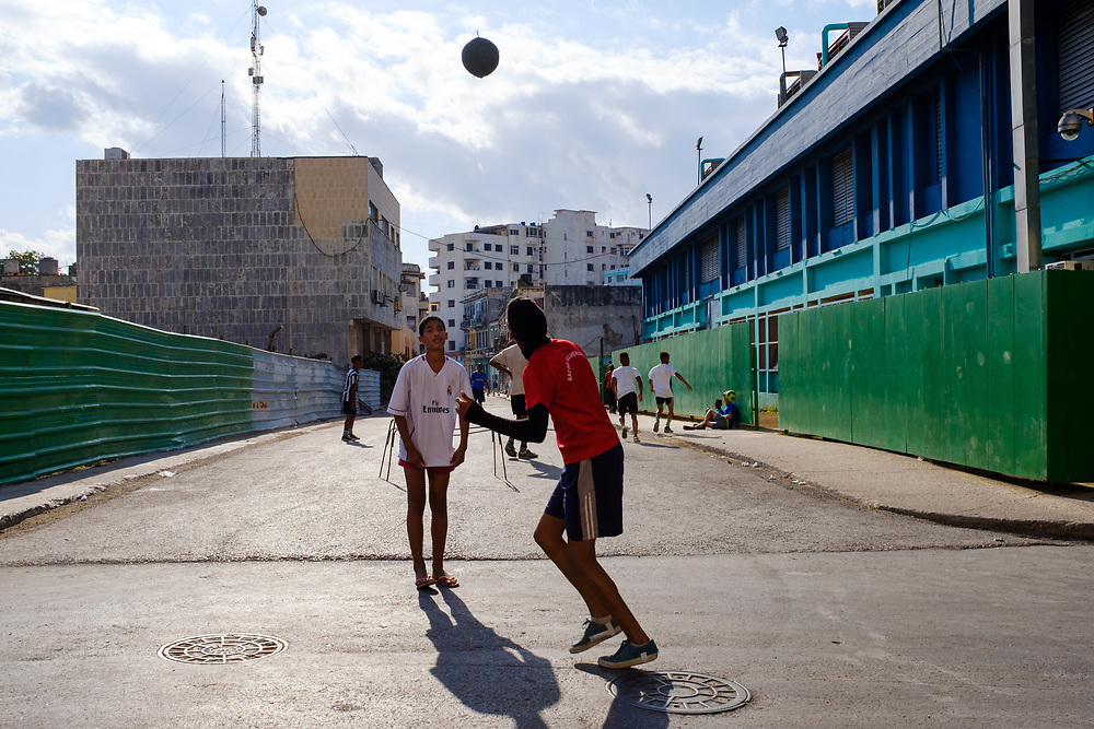 HAVANA, CUBA - CIRCA MARCH 2017:  Boys playing soccer in the streets of  Havana. This is very typical around town.