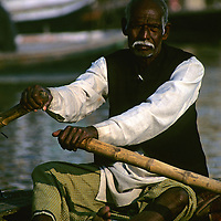 Asia, India, Uttar Pradesh, Varanasi. Boatman on the Varanasi River.
