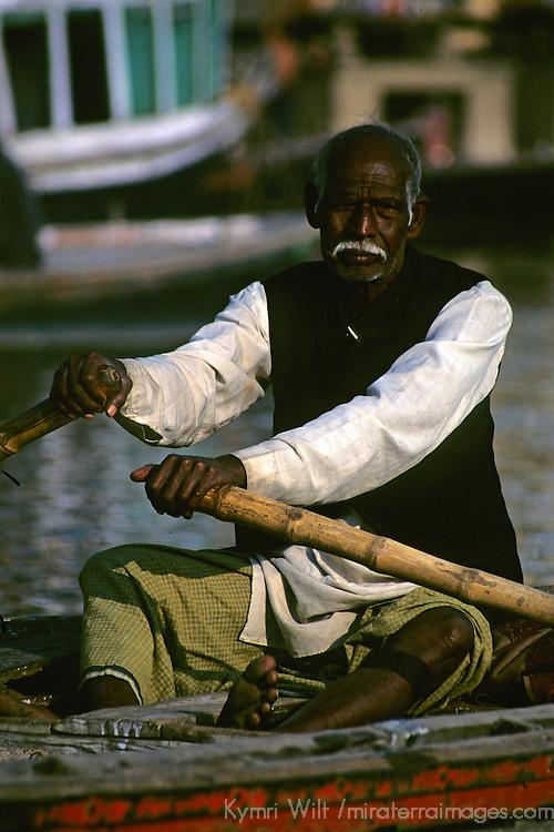Asia, India, Uttar Pradesh, Varanasi. Boatman on the Varanasi River.