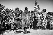 The Dassanach tribe dancing at the Lake Turkana Tribal Festival on the shore of Lake Turkana, black and white,Lake Turkana, Loiyangalani,Kenya, Africa