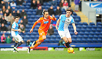 Blackpool's Charles Dunne vies for possession with Blackburn Rovers' Tom Cairney<br /> <br /> Photographer Chris Vaughan/CameraSport<br /> <br /> Football - The Football League Sky Bet Championship - Blackburn Rovers v Blackpool - Saturday 21st February 2015 - Ewood Park - Blackburn<br /> <br /> © CameraSport - 43 Linden Ave. Countesthorpe. Leicester. England. LE8 5PG - Tel: +44 (0) 116 277 4147 - admin@camerasport.com - www.camerasport.com