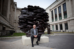 © Licensed to London News Pictures. 24/08/2012. LONDON, UK. British sculptor Tony Cragg is sits on a piece of his work entitled 'Versus 2011'. The piece, one of five on display along the recently pedestrianised Exhibition Road, forms part of an open air exhibition called Tony Cragg at Exhibition Road,. Photo credit: Matt Cetti-Roberts/LNP