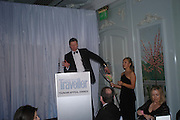 Rory Bremmer drawing the raffle. Conde Nast Traveller Tsunami Appeal dinner. Four Seasons  Hotel. Hamilton Place, London W1. 2 March 2005. ONE TIME USE ONLY - DO NOT ARCHIVE  © Copyright Photograph by Dafydd Jones 66 Stockwell Park Rd. London SW9 0DA Tel 020 7733 0108 www.dafjones.com