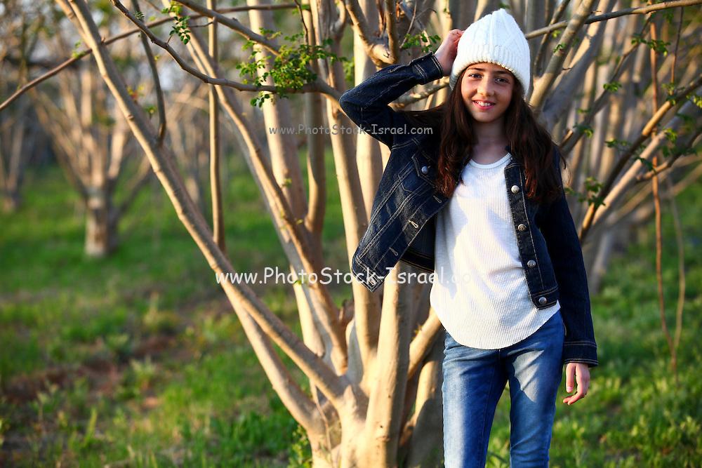 Girl relaxes outdoors,