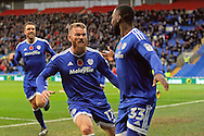 Cardiff City's Aron Gunnarsson (17) celebrates with goal scorer Junior Hoilett (33)  after he scores his teams 2nd goal. EFL Skybet championship match, Cardiff city v Huddersfield Town at the Cardiff city stadium in Cardiff, South Wales on Saturday 19th November 2016.<br /> pic by Carl Robertson, Andrew Orchard sports photography.