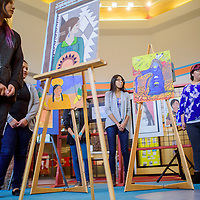 Student artists from several area schools stand by their work during the Brea Foley Portrait Competition at the Navajo Nation Museum in Window Rock Friday.
