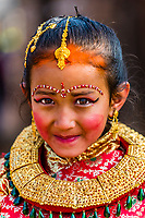 """Young Nepali girls in costume for Bel Bibaha. Nepali females are married three times in their lives: FIrst, Bel Marriage is a ceremony in the Newar community in Nepal in which pre-adolescent girls are """"married"""" to the bael fruit, which is a symbol of the god Vishnu, ensuring that the girl becomes and remains fertile. Swcond time is to the Sun. The third time is to man. Bhaktapur, Kathmandu Valley, Nepal."""