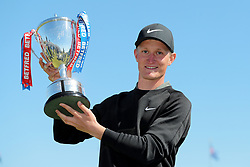 Marcus Kinhult with the trophy after winning on day four of the Betfred British Masters at Hillside Golf Club, Southport.