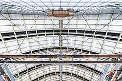 © Licensed to London News Pictures. 09/04/2020. Manchester, UK. Pressurised oxygen pipes are seen framed against the roof of the building . The National Health Service is building a 648 bed field hospital for the treatment of Covid-19 patients , at the historical railway station terminus which now forms the main hall of the Manchester Central Convention Centre . The facility is due to open on Easter Monday , 13th April 2020 , and will treat patients from across the North West of England , providing them with general medical care and oxygen therapy after discharge from Intensive Care Units . Photo credit: Joel Goodman/LNP