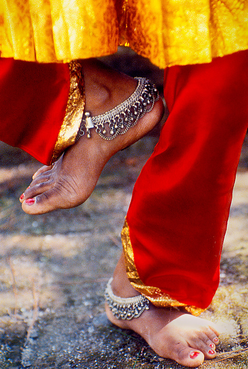 Nepali classical dancer Kanayah Shrestra, her feet adorned with silver anklets, performs a sacred dance re-enacting the creation of the Kathmandu Valley by the gods.