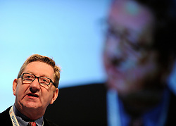 © Licensed to London News Pictures. 29/02/12. LONDON, UK. Len McCluskey has said unions should consider disrupting the London Olympics as part of their campaign against Government cuts. FILE PICTURE: Len McCluskey from the UNITE union addresses The Labour Party Conference in Liverpool today (2829/09/11). Photo credit:  Stephen Simpson/LNP