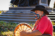12 OCTOBER 2020 - DES MOINES, IOWA: RALPH MOISA, a member of the Yacqui tribe, drums during the Indigenous Day ceremony on the south lawn of the Iowa State Capitol. About 150 people attended the Indigenous Peoples Day 2020 observance at the Iowa State Capitol. They protested the theft and colonization of indigenous lands and the presence of a bust honoring Christopher Columbus on the capitol grounds.     PHOTO BY JACK KURTZ