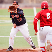 041013       Cable Hoover<br /> <br /> Gallup Bengal Matt Mataya (25) reaches for the ball to stop the advance of Valencia Jaguar Tyler Klein (3) Wednesday at Ford Canyon Park.