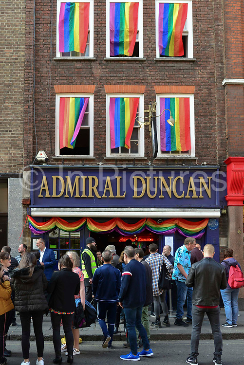 Members of the LGBTI gather outside the Admiral Duncan pub in London, England, United Kingdom on 30th April 2019.Twenty years since a Neo-Nazi set of a nail bomb at the Admiral Duncan pub a iconic gay venue in Soho killing three people and wounded 79. Four of the survivors had to have limbs amputated.