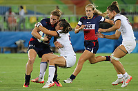 August 08, 2016; Rio de Janeiro, Brazil; USA Women's Eagles Sevens Alev Kelter is caught by the French defense during the Women's Rugby Sevens 5th Place Play-Off match on Day 3 of the Rio 2016 Olympic Games at Deodoro Stadium. Photo credit: Abel Barrientes - KLC fotos