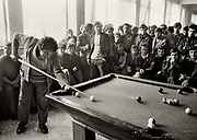 Pool game in the community centre, Korce, Albania. <br /> The goverment figures at that time show full employment but because of the closure of many industrial industries in the 1990's, 25% of the state employees were redundant & unnecessary.