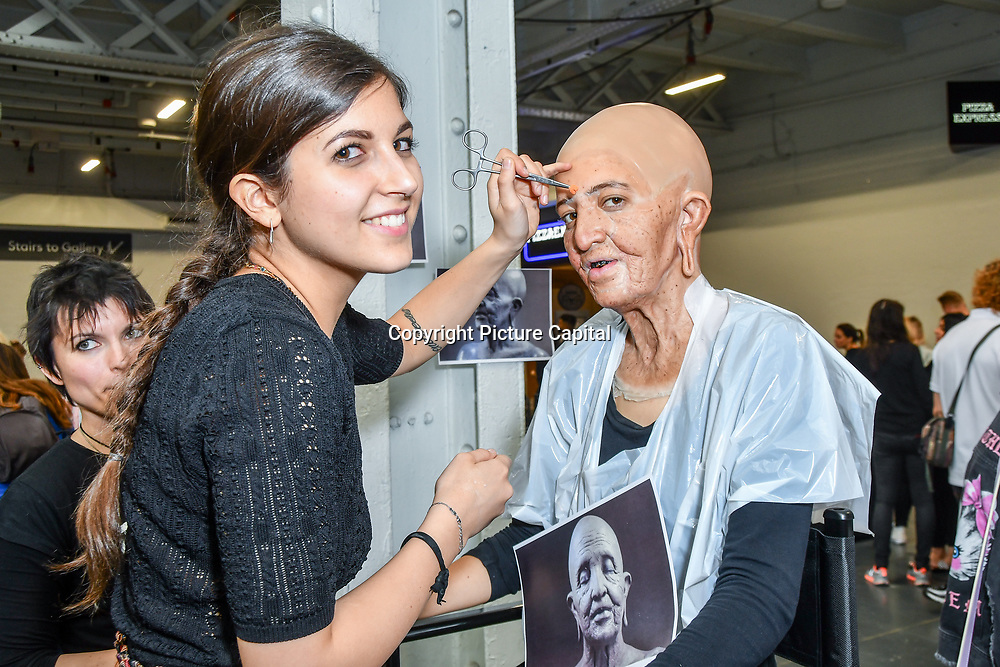 Camilla Cavenaghi re-creating  the make-up of an old woman of the Konyak tribe with a 25 years old model demo at IMATS London on 18 May 2019,  London, UK.