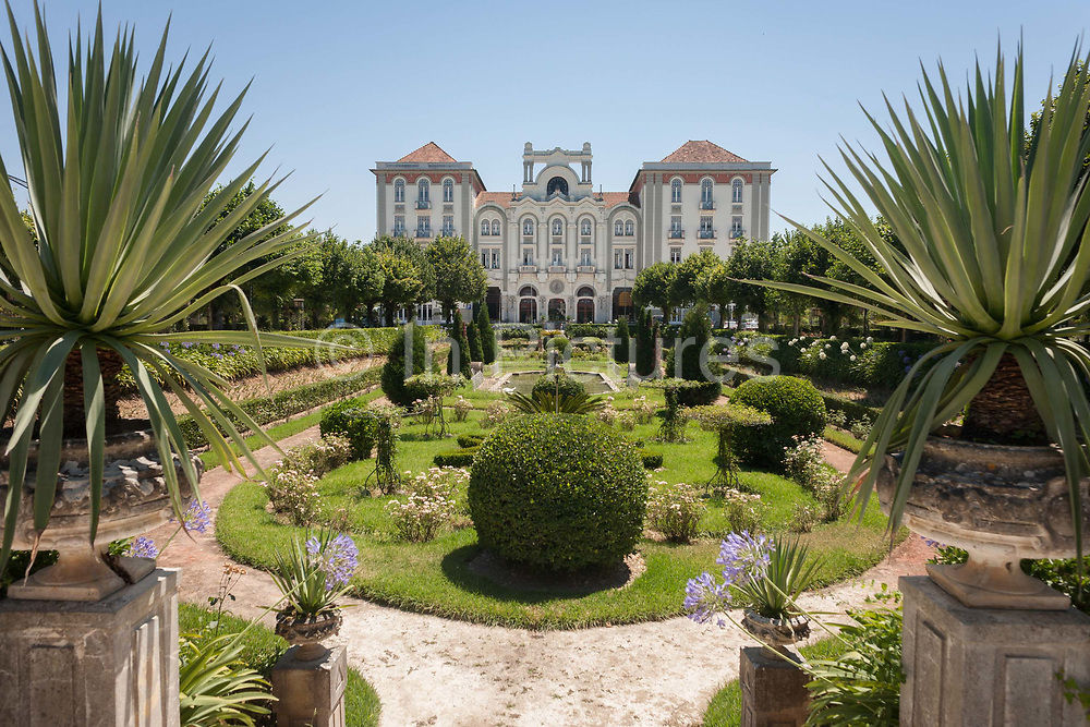 Nostalgic Belle Epoque and Art Nouveau architecture of the Palace Hotel, on 17th July 2016, in Cura, Portugal. The Palace Hotel is one of Portugals most magnificent, restored to its original Golden Twenties style and grandeur and located between Coimbra and Porto. From the beginning of the 20th century onwards, Curia, has been a meeting place for celebrities and Portuguese bourgeoisie, who were attracted by the springs as well as by its cosmopolitan hotels hotels, the casino, the idyllic spa park and wines of the region.
