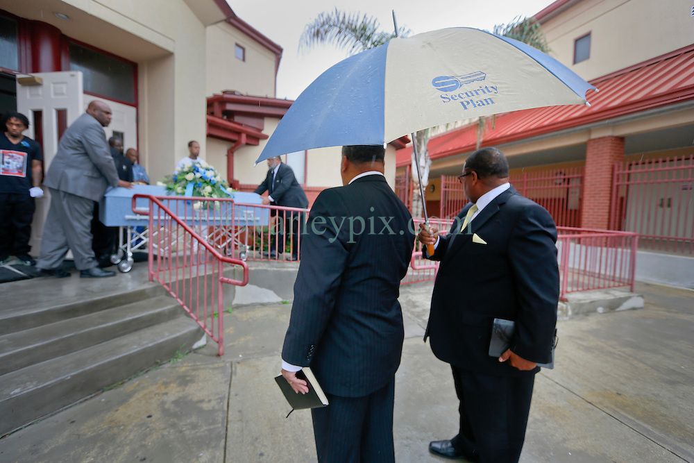 03 June 2014. New Orleans, Lousiana. <br /> Pall bearers at the funeral for teenage shooting victim Dwayne Matthew Joseph at the Franklin Avenue Baptist Church. 17 year old Joseph was shot and killed following an altercation in the street May 26th. Raised by his great grandmother Catherine Robinson, family and friends confirmed Dwayne was a good kid who went to church, looked after his younger siblings and had never been in trouble with the law. Dwayne's older brother Damien preceded him in death. He too was shot dead in February 2011 aged just 19 years.<br /> Photo; Charlie Varley/varleypix.com