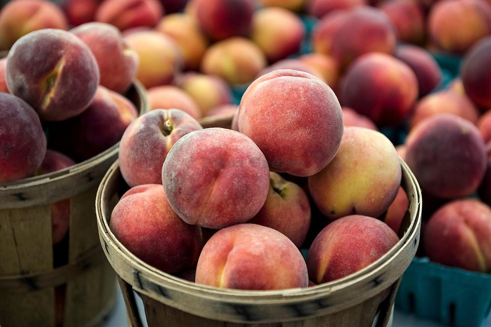 Fresh peaches at a farm market.