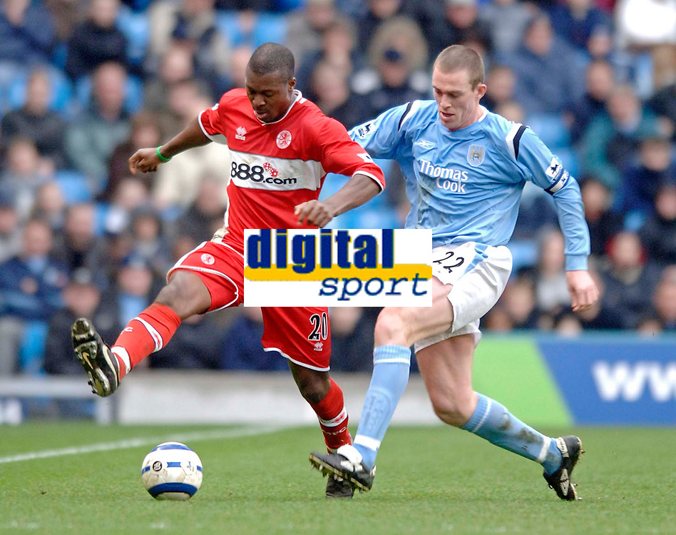 Photo: Glyn Thomas.<br />Manchester City v Middlesbrough. The Barclays Premiership. 02/04/2006.<br /> Man City's Richard Dunne (R) looks to tackle Boro's Yakubu.