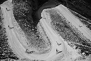 SHOT 10/14/16 2:06:08 PM - Mountain bikers descend the Horsethief Trail section of the White Rim Trail. The White Rim is a mountain biking trip in Canyonlands National Park just outside of Moab, Utah. The White Rim Road is a 71.2-mile-long unpaved four-wheel drive road that traverses the top of the White Rim Sandstone formation below the Island in the Sky mesa of Canyonlands National Park in southern Utah in the United States. The road was constructed in the 1950s by the Atomic Energy Commission to provide access for individual prospectors intent on mining uranium deposits for use in nuclear weapons production during the Cold War. Four-wheel drive vehicles and mountain bikes are the most common modes of transport though horseback riding and hiking are also permitted.<br /> (Photo by Marc Piscotty / © 2016)
