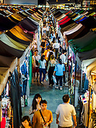 05 MARCH 2019 - BANGKOK, THAILAND:  People walk through the Ratchada Night Market. The Ratchada Night Market is the newest night market in Bangkok. It was originally a small night market popular with local people but now is tourism destination. Most nights the market is jammed with foreign tourists.   PHOTO BY JACK KURTZ
