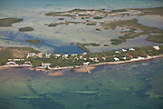 Aerial of homes along a narrow strip of land in Sugar Loaf Key, Florida.