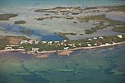 Aerial of homes along a narrow strip of land in Sugar Loaf Key, Florida.