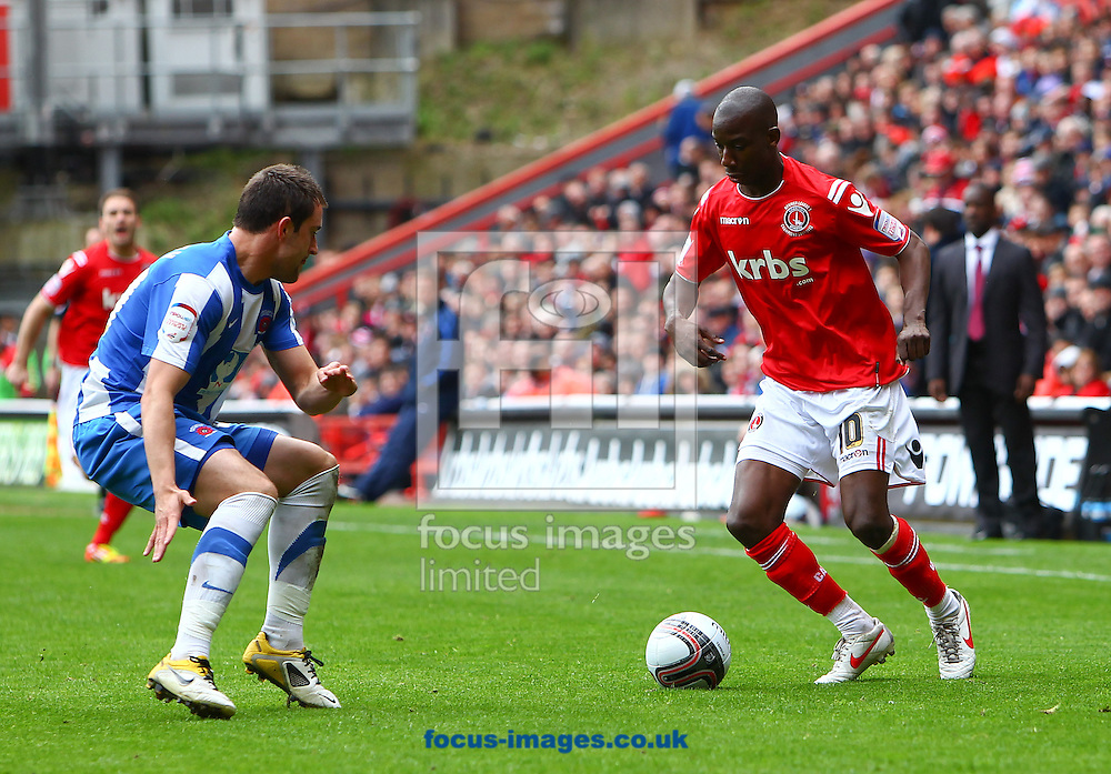 Picture by John Rainford/Focus Images Ltd. 07506 538356.05/05/12.Bradley Wright-Phillips of Charlton Athletic and Peter Hartley of Hartlepool United during the Npower League 1 match at The Valley stadium, London.